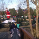 Santa waving to the runners